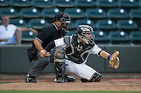 Winston-Salem Dash catcher Brett Austin (7) sets a target as home plate umpire Cody Clark looks on during the game against the Lynchburg Hillcats at BB&T Ballpark on April 28, 2016 in Winston-Salem, North Carolina.  The Dash defeated the Hillcats 4-1.  (Brian Westerholt/Four Seam Images)