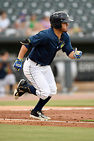 Right fielder Arnaldo Berrios (3) of the Columbia Fireflies runs toward first in a game against the Charleston RiverDogs on Monday, August 7, 2017, at Spirit Communications Park in Columbia, South Carolina. Columbia won, 6-4. (Tom Priddy/Four Seam Images)