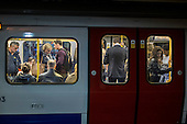 London rush hour passengers on a train at Baker Street underground station