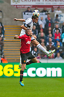 Saturday 17 August 2013<br /> <br /> Pictured: Angel Rangel makes a mid air challenge with Tom Cleverley of Manchester United<br /> <br /> Re: Barclays Premier League Swansea City v Manchester United at the Liberty Stadium, Swansea, Wales