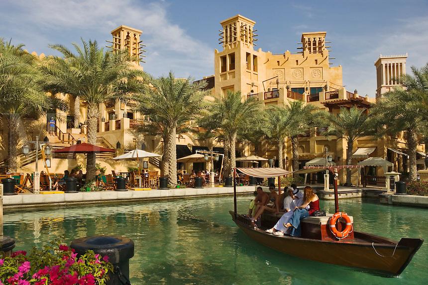 Visitors take water taxi/abra from the souk at Madinat Jumeirah. Dubai. United Arab Emirates.