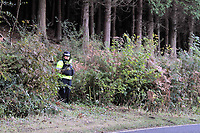 Pictured: Police at the scene where the body of 15 year old Rebecca Aylward was discovered. Monday 25 October 2010<br /> Re: South Wales Police are investigating the murder of 15 year old Rebecca Aylward from Maesteg in south Wales. Her body was discovered in woodlands outside Aberkenfig near Bridgend. Two fifteen year old men have been arrested.