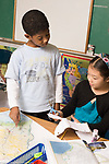 Elementary School Grade 3 social students map project boy and girl working together