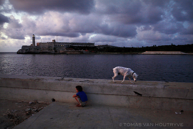 A boy and a dog along the sea in Havana, Cuba on 8 August 2006.<br />