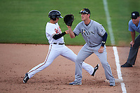 Mesa Solar Sox first baseman Casey Gillaspie (15) waits for a throw as Adrian Marin (2) gets back to the bag on a pickoff attempt during an Arizona Fall League game against the Peoria Javelinas on October 21, 2015 at Peoria Stadium in Peoria, Arizona.  Peoria defeated Mesa 5-3.  (Mike Janes/Four Seam Images)