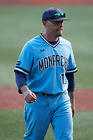 Old Dominion Monarchs pitching coach Mike Marron (13) walks off the field during the game against the Charlotte 49ers at Hayes Stadium on April 25, 2021 in Charlotte, North Carolina. (Brian Westerholt/Four Seam Images)