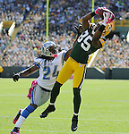 Green Bay Packers receiver Greg Jennings, right, beats Detroit's Jonathan Wade for a touchdown during the second quarter of the game at Lambeau Field in Green Bay, Wis., on Oct. 3, 2010.
