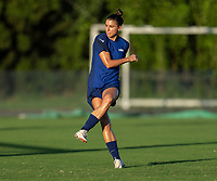 KASHIMA, JAPAN - AUGUST 4: Alex Morgan #13 of the USWNT takes a shot during a training session at the practice field on August 4, 2021 in Kashima, Japan.