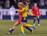 COLUMBUS, OH - NOVEMBER 07: Lindsey Horan #9 of the United States fights for the ball with Kosovare Asllani #9 of Sweden during a game between Sweden and USWNT at Mapfre Stadium on November 07, 2019 in Columbus, Ohio.