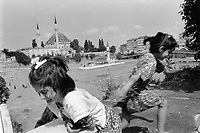 Turkey. Istanbul. Two young girls play near the Yavuz Selim Mosque, also known as the Selim I Mosque. The Yavuz Sultan Selim Mosque is a 16th-century Ottoman imperial mosque located at the top of the 5th Hill of Istanbul, in the neighborhood of Çukurbostan, overlooking the Golden Horn. Its size and geographic position make it a familiar landmark on the Istanbul skyline. Istanbul is the largest city in Turkey and the country's economic, cultural and historic center. The city straddles the Bosphorus strait, and lies in both Europe and Asia. 3.07.92 © 1992 Didier Ruef