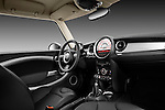 Straight dashboard view of a 2011 Mini Cooper Clubman S.