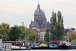 Boats moored along the Het Ij Amsterdam, Netherlands