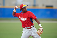 Philadelphia Phillies third baseman Maikel Franco (12) warmup throw to first during an instructional league game against the Toronto Blue Jays on September 28, 2015 at the Englebert Complex in Dunedin, Florida.  Franco is on rehab for a wrist injury.  (Mike Janes/Four Seam Images)