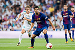 Andre Filipe Tavares Gomes (r) of FC Barcelona is followed by Luka Modric of Real Madrid during their Supercopa de Espana Final 2nd Leg match between Real Madrid and FC Barcelona at the Estadio Santiago Bernabeu on 16 August 2017 in Madrid, Spain. Photo by Diego Gonzalez Souto / Power Sport Images