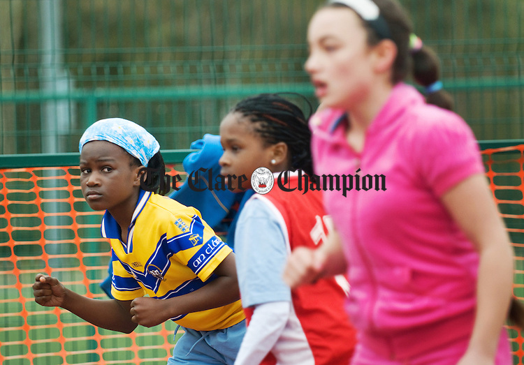 Elizabeth Njekure looks across at the competition during her 100m race at the  Ennis Parish National Schools Athletics day at Lees Road. Photograph by John Kelly.
