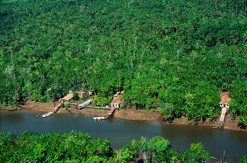 Aerial of riverside houses with rainforest in background in Amazon-Tocantins estuary complex, Brazil, Para..