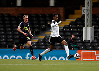 23rd May 2021; Craven Cottage, London, England; English Premier League Football, Fulham versus Newcastle United; Tosin Adarabioyo of Fulham passing the ball into midfield while being marked by Sean Longstaff of Newcastle United
