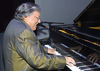 Miami Beach, FL 11-13-2001<br /> Emmy and Grammy award-winning jazz musician Arturo Sandoval plays the piano after being awarded for 30 years of musical excellence.<br /> <br /> Photo by Adam Scull/PHOTOlink