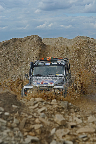 Land Rover Defender, racing at the Rallye Dresden Breslau 2007, crossing through a ford. --- No releases available. Automotive trademarks are the property of the trademark holder, authorization may be needed for some uses.