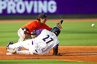Frederick Keys shortstop Sammy Starr (6) waits for the throw as Yoandy Barroso (27) of the Winston-Salem Dash slides into second base with a double at BB&T Ballpark on May 28, 2013 in Winston-Salem, North Carolina.  The Dash defeated the Keys 17-5 in the first game of a double-header.  (Brian Westerholt/Four Seam Images)