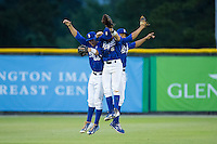 (L-R) Brandon Thomasson (66), Ben Johnson (6) and Anderson Miller (12) of the Burlington Royals celebrate their win over the Danville Braves at Burlington Athletic Park on July 12, 2015 in Burlington, North Carolina.  The Royals defeated the Braves 9-3. (Brian Westerholt/Four Seam Images)