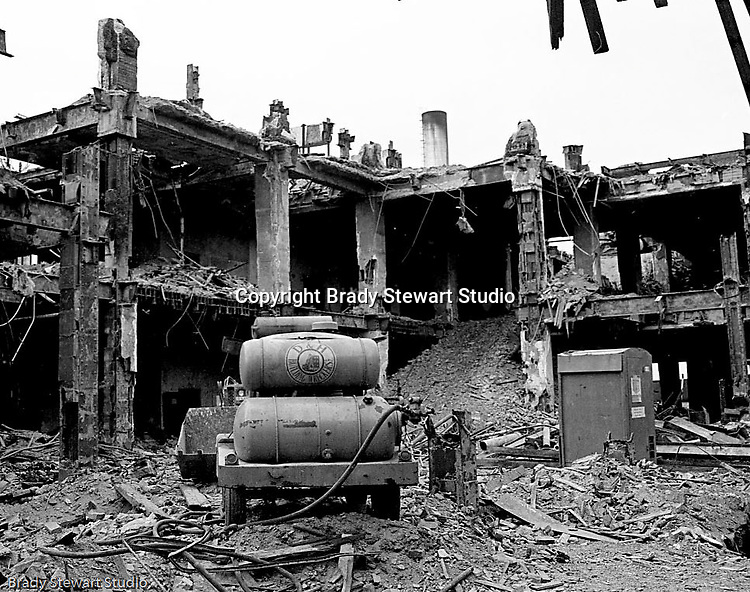 Pittsburgh PA:  View of the building demolition of one of downtown Pittsburgh's grand department stores, Rosenbaums. Bulldozer and gas compressor at work site.  Located at Penn Avenue and Sixth Street in Pittsburgh, the store closed in 1960 and taken down in 1963 to make way for the Sixth Avenue garage.  The demolition work was completed by D&H Building Wreckers.