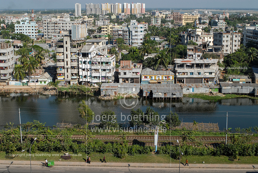 BANGLADESH, Dhaka city, view on river and suburb with apartment block buildings