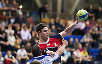02 NOV 2011 - LONDON, GBR - Britain's Steve Larsson (#14 - blue and red) taps the ball to a team mate during the Men's 2013 World Handball Championship qualification match against Israel at the National Sports Centre at Crystal Palace .(PHOTO (C) NIGEL FARROW)