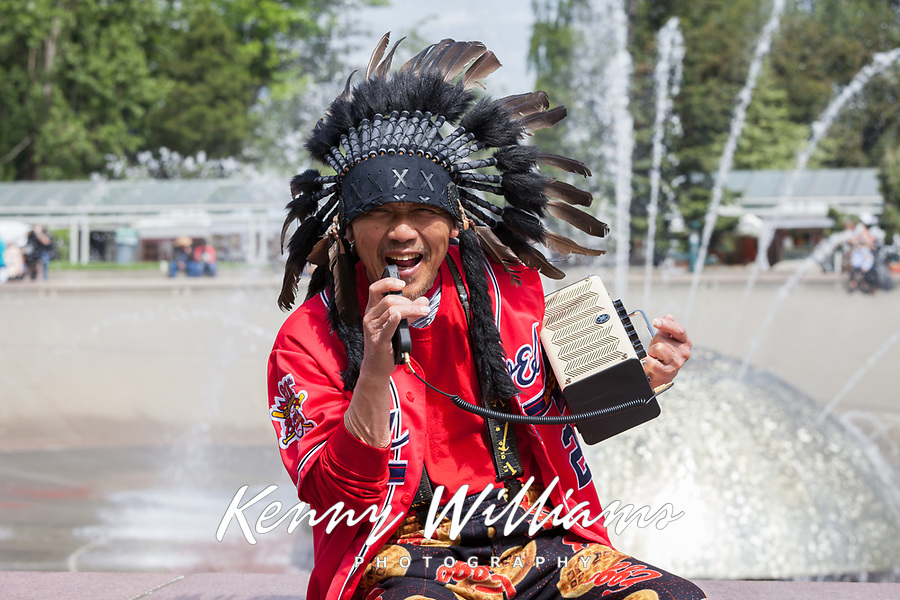 Native American with black feather headdress, singing retro music, NW Folklife Festival, Seattle, WA, USA.