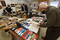 BOOK BROWSERS<br />Bill Cole of Bella Vista looks at military history books on Saturday Feb. 20 2021 during a benefit book sale at the Bella Vista Historical Museum. Sales helped fund activities of the area Civil War Roundtable that meets monthly. Books came mainly from the library of Bella Vista American Legion Post 341, which closed recently, and from personal collections. The museum is open from 1 to 5 p.m. Saturdays and Sundays. Admission is free. The musuem showcases the history of Bella Vista and nearby area with an array of items in several rooms. Go to nwaonline.com/210221Daily/ to see more photos.<br />(NWA Democrat-Gazette/Flip Putthoff)
