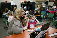 Kim Crawford, kindergarten teacher, (from left) helps Emilea May with an assignment, Monday, October 5, 2020 at Clinton Elementary School in Clinton. Check out nwaonline.com/2010010Daily/ for today's photo gallery. <br /> (NWA Democrat-Gazette/Charlie Kaijo)