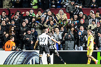 14.03.2013 Newcastle, England. Newcastle's Steven Taylor and Papiss Cisse celebrate in front of fans as a last minute goal puts them through to the next round during the Europa League game between Newcastle and Anzhi Makhachkala from St James Park.