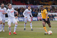 Souleymane Coulibaly of Newport County takes on Elliott Hewitt of Notts County during the Sky Bet League 2 match between Newport County and Notts County at Rodney Parade, Newport, Wales on 30 April 2016. Photo by Mark  Hawkins / PRiME Media Images.