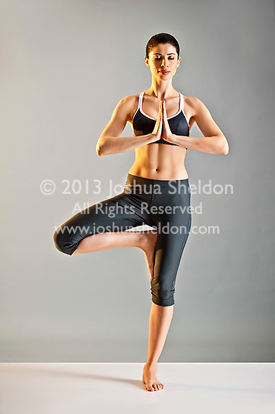 Young Caucasian woman doing yoga