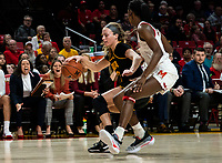 COLLEGE PARK, MD - FEBRUARY 13: Diamond Miller #14 of Maryland guards Makenzie Meyer #3 of Iowa during a game between Iowa and Maryland at Xfinity Center on February 13, 2020 in College Park, Maryland.