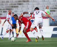 Michael Seaton (29) of the Richmond Kickers fights for the ball with Conor Shanosky (17) of D.C. United during a third round match in the US Open Cup at City Stadium in Richmond, VA.  D.C. United advanced on penalty kicks after tying the Richmond Kickers, 0-0.
