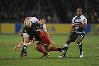 Gonzalo Camacho of Leicester Tigers escapes the clutches of Petrus du Plessis of Saracens during the Premiership Rugby match between Saracens and Leicester Tigers - 02/01/2016 - Allianz Park, London<br /> Mandatory Credit: Rob Munro/Stewart Communications