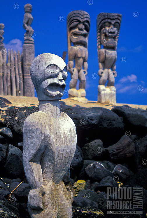 Giant carved wooden statues stand  guard at the Pu'uhonua o Honaunau National Historical Park also know as the City of Refuge. A restored place of refuge for those who had broken taboos or were defeated in battle.  Located in south Kona.
