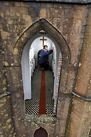 BNPS.co.uk (01202 558833)<br /> Pic: ZacharyCulpin/BNPS<br /> <br /> Pictured: During the winter months restoration of the town takes place. Volunteer Niki Turner hard at work in the mini Wimborne Minster.<br /> <br /> A popular model village has installed 1950s style road signs in a bid to ensure social distancing.<br /> <br /> Wimborne Model Town in Dorset is due to open back up to the public at the end of March and was desperate to adhere to government guidelines.