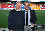St Johnstone Player of the Year Awards 2014-15.....16.05.15<br /> Andrew Holden presents the SJFC Disabled Supporters Association Player of the Year Award to Chris Millar<br /> Picture by Graeme Hart.<br /> Copyright Perthshire Picture Agency<br /> Tel: 01738 623350  Mobile: 07990 594431