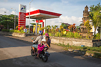 Bali, Indonesia.  Road Safety.  Mother and daughter on Rear of Motorbike, no Helmets.