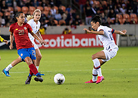 HOUSTON, TX - FEBRUARY 03: Raquel Chacon #20 of Costa Rica passes the ball by Christen Press #20 of the USA during a game between Costa Rica and USWNT at BBVA Stadium on February 03, 2020 in Houston, Texas.