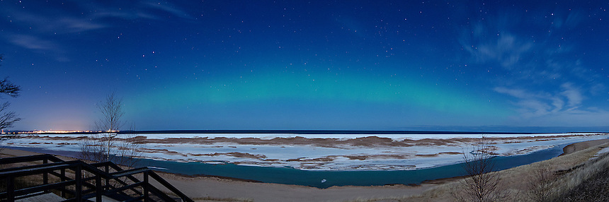 A view of the Northern Lights and Lake Superior during a moonlit evening. Marquette, MI