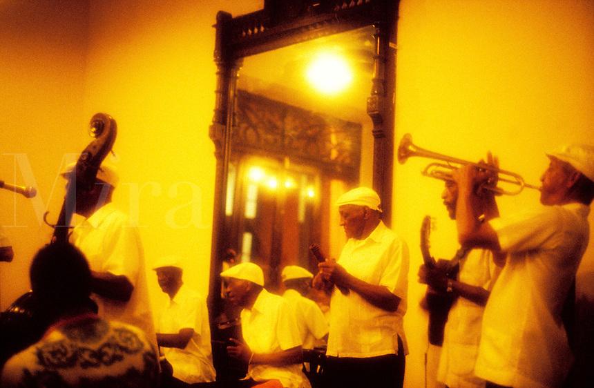 Cuba, Havana. Musicians playing in a bar..MODEL RELEASED