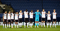 Bolton Wanderers' players  observe a minutes silence before the match<br /> <br /> Photographer Andrew Kearns/CameraSport<br /> <br /> The EFL Sky Bet League Two - Bolton Wanderers v Mansfield Town - Tuesday 3rd November 2020 - University of Bolton Stadium - Bolton<br /> <br /> World Copyright © 2020 CameraSport. All rights reserved. 43 Linden Ave. Countesthorpe. Leicester. England. LE8 5PG - Tel: +44 (0) 116 277 4147 - admin@camerasport.com - www.camerasport.com