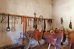 Historic Spanish riding tack, saddles, stirrups, shoes, shoe laths, reings and bridle at Mission La Purisima State Historic Park, Lompoc, California.  Mission La Purisima, founded in 1787 by Franciscan Padre Presidente Fermin Francisco Lasuen. La Purisima was the eleventh mission of the twenty-one Spanish Missions established in what later became the state of California.