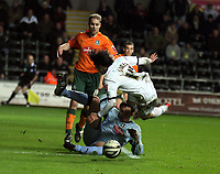ATTENTION SPORTS PICTURE DESK<br /> Pictured: Jordi Gomez of Swansea (14) is toppled over by Romain Larrieu, goalkeeper for Plymouth Argyle (on the ground) which earned the former's team a penalty scored by Jason Scotland (not pictured).<br /> Re: Coca Cola Championship, Swansea City FC v Plymouth Argyle at the Liberty Stadium, Swansea, south Wales. 10 March 2009.<br /> Picture by D Legakis Photography / Athena Picture Agency, Swansea 07815441513