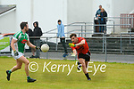 Wk27 Glenbeigh/Glencar's captain Tommy Cahill takes a catch in front of  Na Gael's Eoin O'Neill in the 10pt to 1-7 draw in Glenbeigh on Sunday