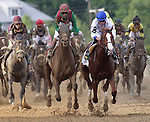 Shackleford (blue cap), Jesus Lopez Castanon up, wins the136th running of the Preakness Stakes at Pimlico Race Course, May 21, 2011. Animal Kingdom (red cap, green sleeves), John Velazquez up, is second. (Joan Fairman Kanes/Eclipsesportswire)