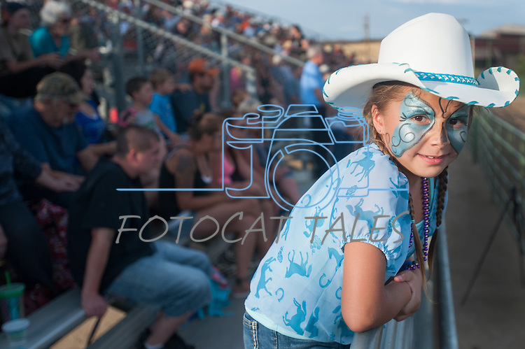 Destiny Ledford, 6, watches the Minden Ranch Rodeo Buckaroo Fest during the NV150 Fair at Fuji Park in Carson City, Nev., on Saturday, August 2, 2014.<br /> (Photo By Kevin Clifford)